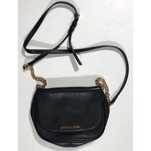 "Michael Kors purse black and gold. 9"" x 6.5""."